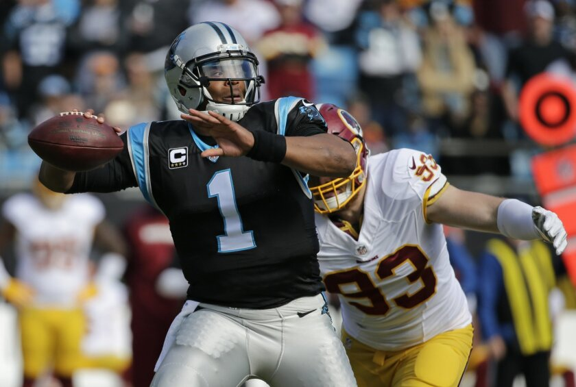 Carolina Panthers' Cam Newton (1) looks to pass under pressure from Washington Redskins' Trent Murphy (93) in the first half of an NFL football game in Charlotte, N.C., Sunday, Nov. 22, 2015. (AP Photo/Chuck Burton)