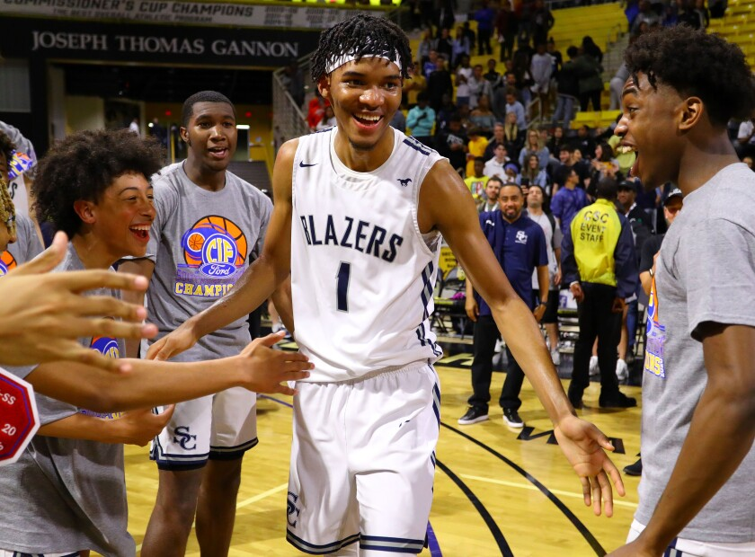 Sierra Canyon's Ziaire Williams (1) celebrates with teammates after the Trailblazers won the Southern Section Open Division championship on Feb. 28, 2020, in Long Beach.