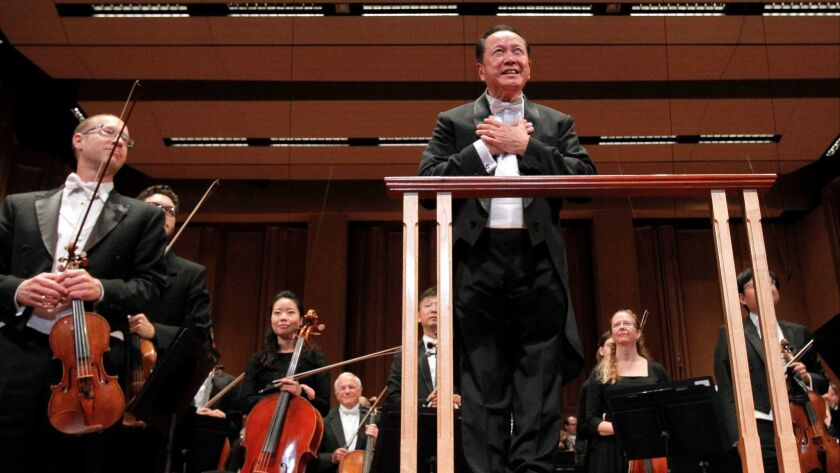 San Diego Symphony music director Jahja Ling acknowledges audience applause after conducting Friday night's concert.