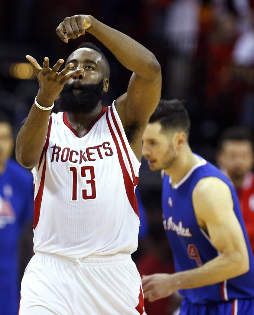 Houston Rockets guard James Harden (13) gestures after scoring against the Los Angeles Clippers during the third quarter of Game 7 of the NBA Western Conference semifinals at the Toyota Center Sunday, May 17, 2015, in Houston. (James Nielsen / Houston Chronicle via AP ) Mandatory Credit