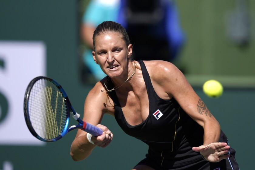 Karolina Pliskova, of the Czech Republic, returns a shot to Magdalena Frech, of Poland, at the BNP Paribas Open tennis tournament Saturday, Oct. 9, 2021, in Indian Wells, Calif. (AP Photo/Mark J. Terrill)