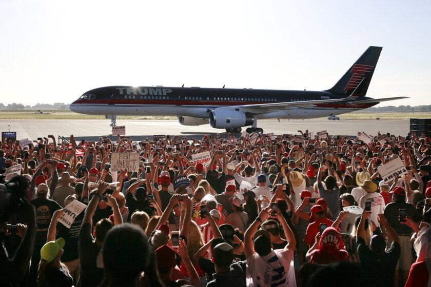 Supporters take pictures of Republican presidential candidate Donald Trump's plane as as it taxies to a hanger for a rally, Wednesday, June 1, 2016, in Sacramento, Calif. (AP Photo/Jae C. Hong)