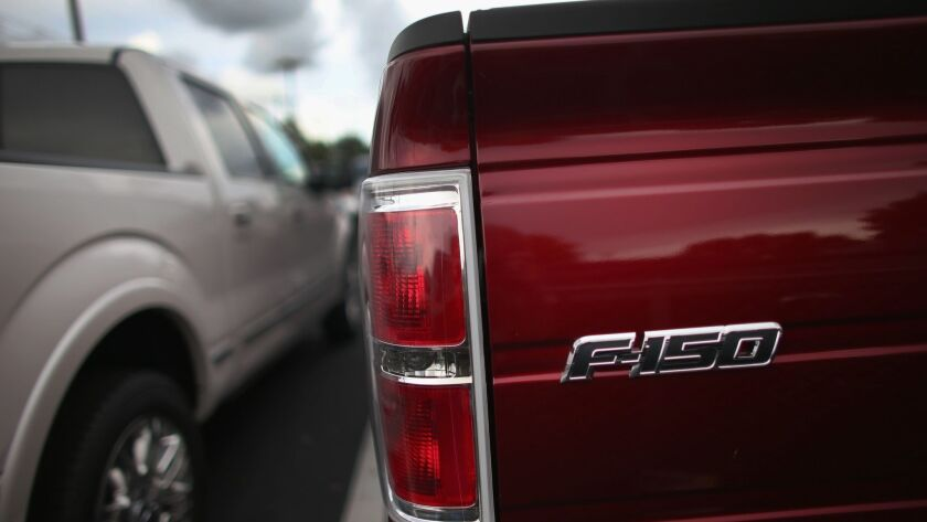 Ford is recalling 350,000 trucks and SUVs that might move