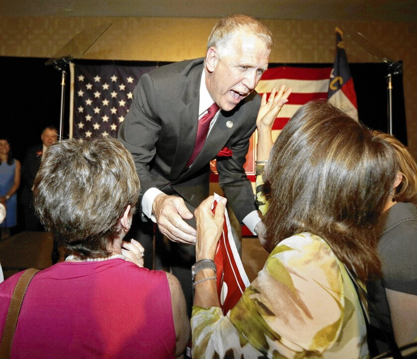 Thom Tillis greets supporters Tuesday after winning the GOP nomination to challenge North Carolina Sen. Kay Hagan.