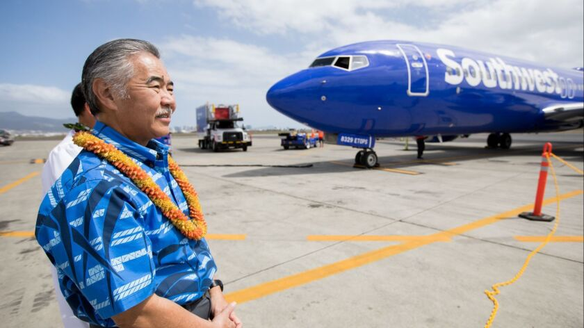 Hawaii Gov. David Ige greets the Southwest Airlines inaugural flight to Hawaii touches down in Danie
