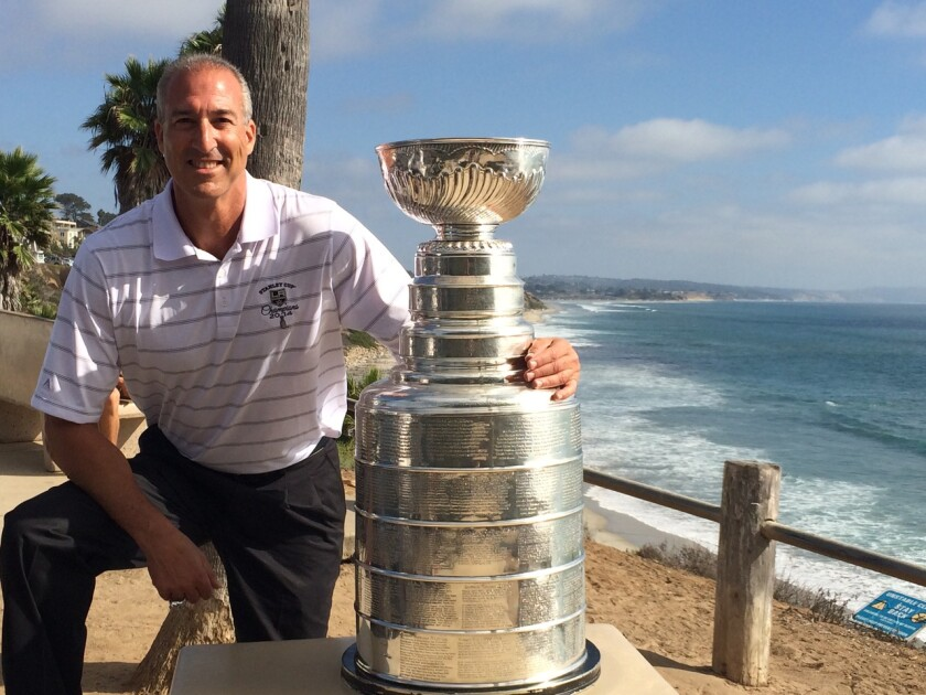 Jeff Solomon, the Kings' executive vice president of hockey operations and legal affairs, poses with the Stanley Cup.