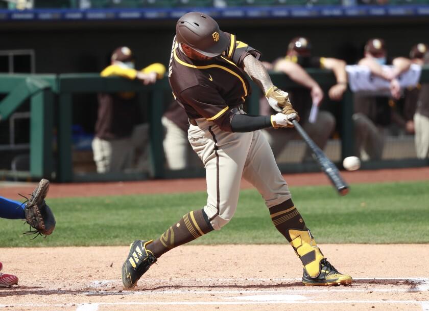 Padres third baseman Nick Tanielu hits a home run against the Texas Rangers on Thursday.