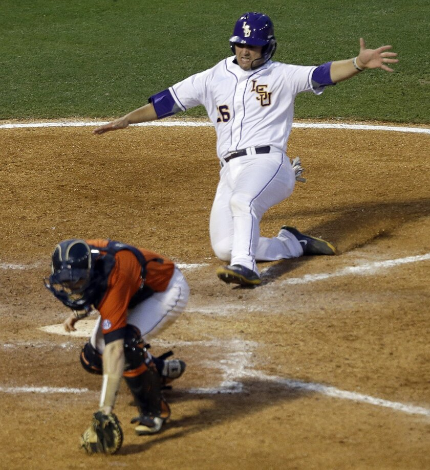 LSU's Chris Chinea (26) slides safely into home plate as Auburn's Blake Logan (1) chases an errant throw during the fifth inning of a game at the Southeastern Conference college baseball tournament at the Hoover Met, Wednesday, May 20, 2015, in Hoover, Ala. (AP Photo/Butch Dill)