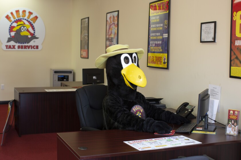 Elias Ortiz, dressed as Max the Magpie, inside Fiesta Auto Insurance in East L.A.