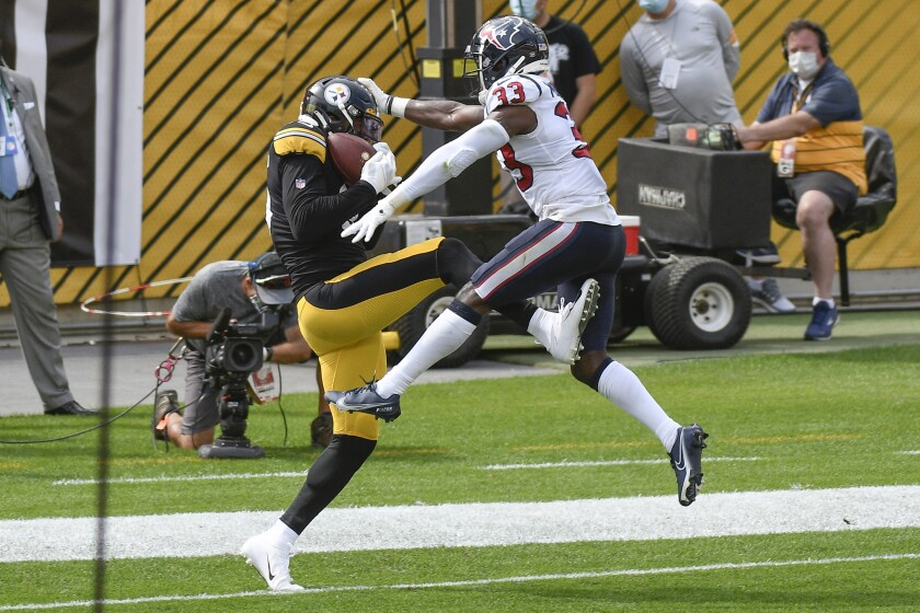 Pittsburgh Steelers tight end Eric Ebron (85) makes a touchdown catch near Houston Texans safety A.J. Moore (33) in the first half of an NFL football game, Sunday, Sept. 27, 2020, in Pittsburgh. (AP Photo/Don Wright)