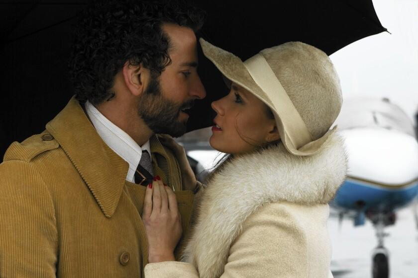 """Bradley Cooper's live-wire FBI agent falls for Amy Adams' con artist in """"American Hustle."""""""
