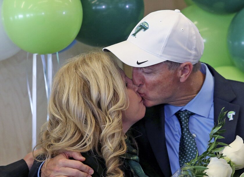 Willie Fritz kisses his wife Susan after he is formally introduced as Tulane's head football coach during a news conference at Yulman Stadium at Tulane University in New Orleans on Tuesday, Dec. 15, 2015. (Michael DeMocker/NOLA.com The Times-Picayune via AP) MAGS OUT; NO SALES; USA TODAY OUT; THE B