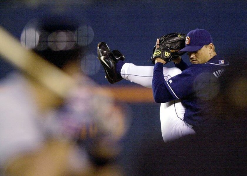 Trevor Hoffman pitches to the Mets' Mike Piazza, the middle out of his 300th save, Aug. 15, 2001.