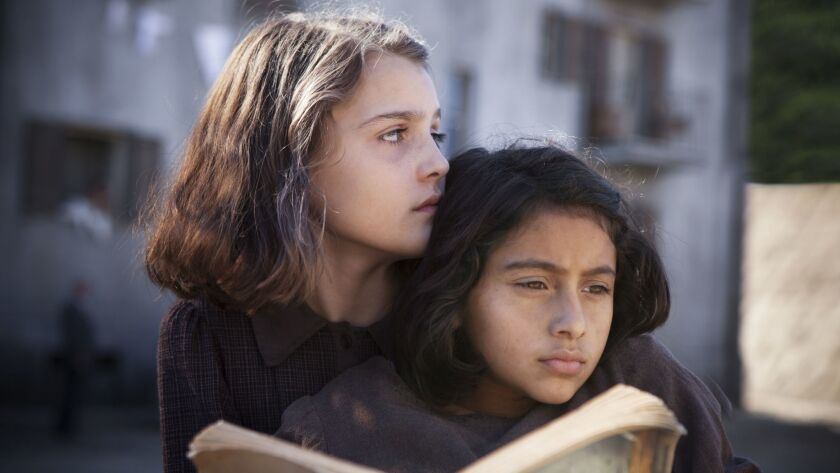 This image released by HBO shows Elisa Del Genio, left, and Ludovica Nasti in a scene from the non-E