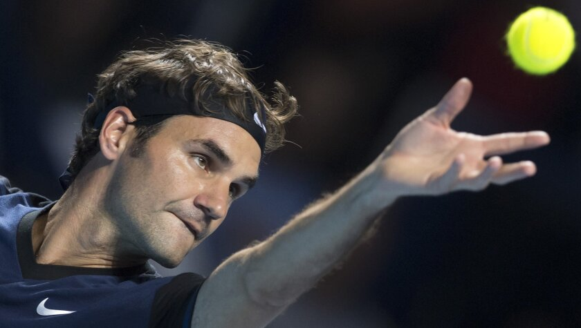 Switzerland's Roger Federer serves a ball to Germany's Philipp Kohlschreiber during their tennis match at the Swiss Indoors tennis tournament at the St. Jakobshalle in Basel, Switzerland, on Thursday, Oct. 29, 2015. (Georgios Kefalas/Keystone via AP)