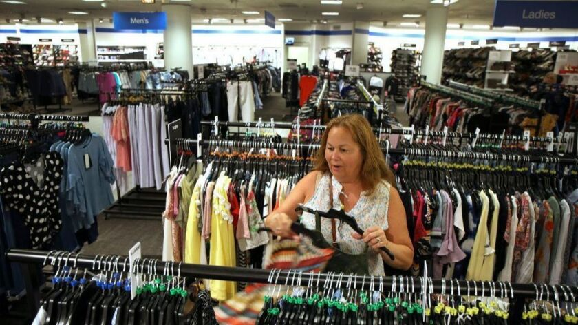 "Judy Fiol, of Morton Grove, shops at Macy's Backstage in Old Orchard Shopping Center in Skokie on July 26, 2018. Backstage is Macy's ""on-mall, off-price concept."" It was Fiol's first time shopping there, and she remarked, ""As long it is nice and neat, I'll shop here."""