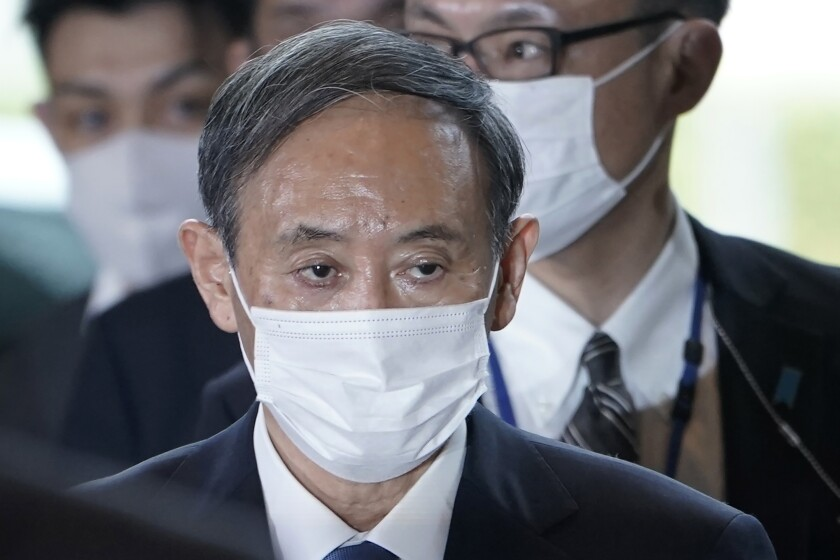 Yoshihide Suga arrives at the Japanese prime minister's office after being elected on Sept. 16, 2020.