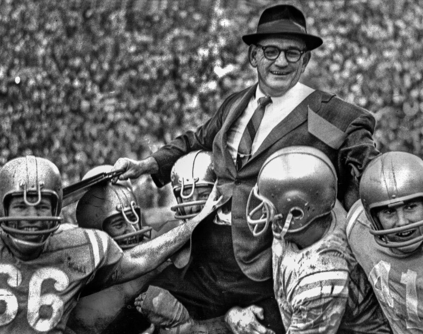 Jan. 1, 1966: UCLA coach Tommy Prothro is hoisted up after the fifth-ranked Bruins beat the Spartans, the No. 1 football team in the nation.