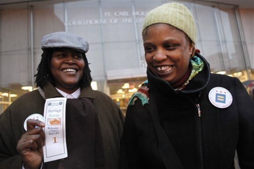 Sinjoyla Townsend, of Washington, left, and her partner Angelisa Young, were the first couple at Superior Court to obtain their marriage license after the District of Columbia legalized gay marriage in Washington, on Wednesday, March 3, 2010. (AP Photo/Jacquelyn Martin)