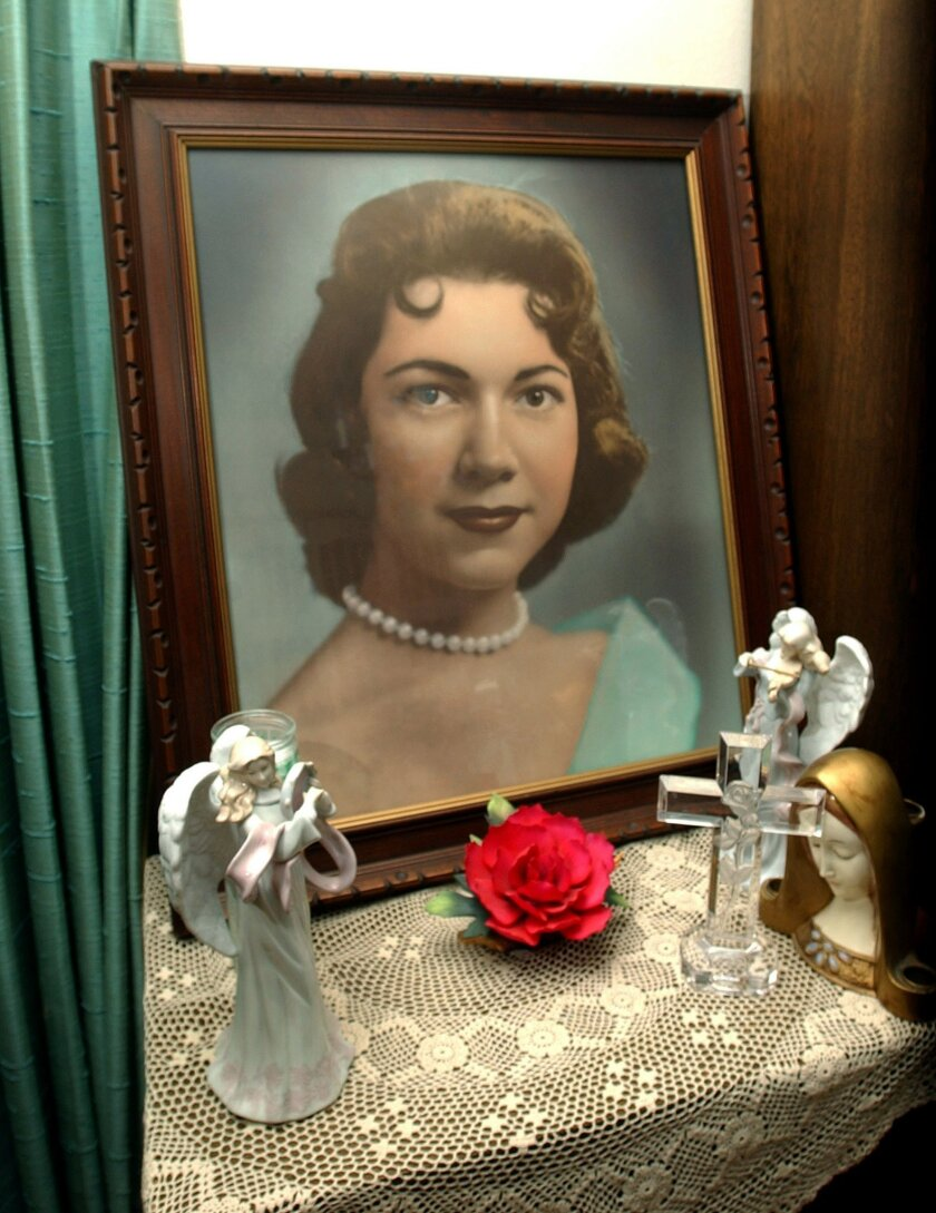 This photo taken on March 11, 2004, shows a portrait of Irene Garza displayed at the home of her aunt Herlynda De La Vina in Edinburg, Texas. A former priest was arrested Tuesday, Feb. 9, 2016, in Arizona in the 1960 slaying of the 25-year-old Texas schoolteacher and beauty queen. (Delcia Lopez /Th