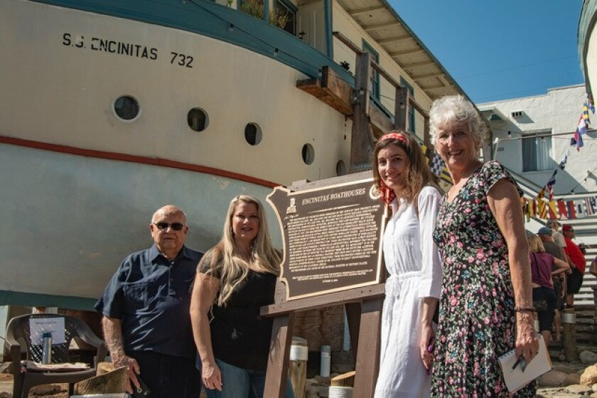 Four of the builder's descendants, who came here for the dedication, posed with the commemorative plaque: Miles J. Kellogg, Stacy Alexander Karp, Rachel Brupbacher and her mother, Nancy Brupbacher.