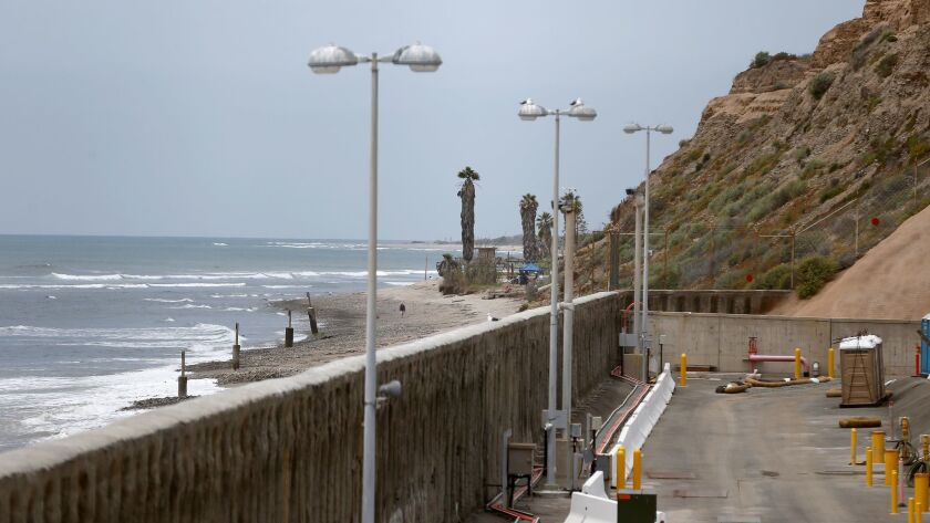 A view of the 27-foot sea wall with San Onofre State Beach in the background at the decommissioned S