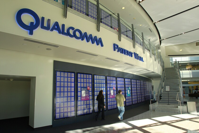 Patents issued to Qualcomm are displayed on the Patent Wall at the Qualcomm headquarters in Sorrento Valley.