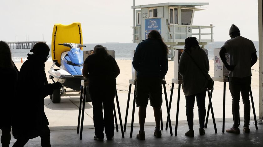 Voters mark their ballots at the Venice Beach Lifeguard Operations Headquarters on June 5.