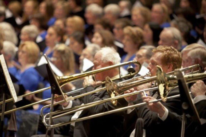 The trombones and chorus prepare for the upcoming season. Courtesy.