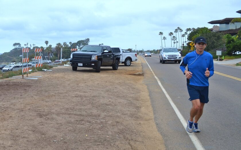 A council majority favors the rail trail running alongside San Elijo Avenue, saying residents would be more likely to bike, run and walk there over Coast Highway 101.