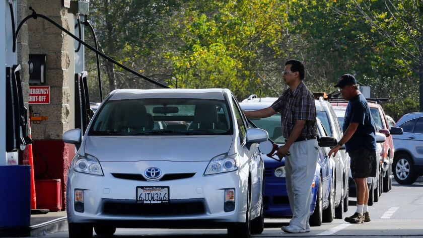People fill up their tanks with gasoline at a Costco Gas Station in Carlsbad, Calif.