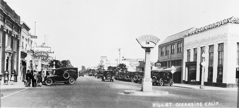 Oceanside's landmark sign in the early 1920s, looking north on Hill Street, now North Coast Highway, from Mission Avenue.