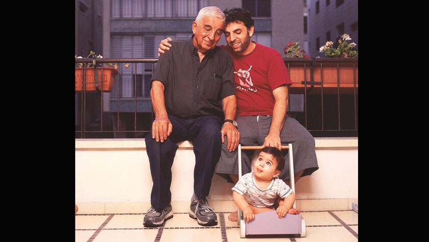 Etgar Keret, right, author of the book 'The Seven Good Years: A Memoir,' with his father and son.