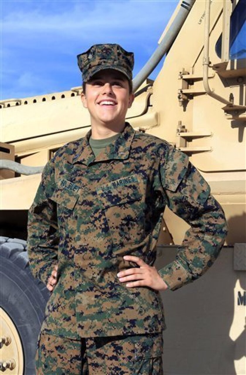 This Nov. 29, 2012 image provided by the United states Marine Corps shows Lt. Brandy Soublet on the Marine base, 29 Palms in Southern California. Soublet is about as far from the war front as possible at her desk in the California desert, but she's on the front lines of an experiment that could one day put women as close to combat as their male peers. The Penfield, N.Y. woman is one of 45 female Marines assigned this summer to 19 all-male combat battalions. (AP Photo/USMC, Cpl. William J. Jackson)