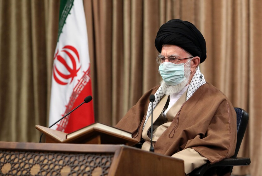 """In this picture released by an official website of the office of the Iranian supreme leader, Supreme Leader Ayatollah Ali Khamenei wearing a protective face mask, attends a meeting in Tehran, Iran, Wednesday, April 14, 2021. Khamenei said Wednesday that the offers being made at the Vienna talks over his country's tattered nuclear deal """"are not worth looking at."""" (Office of the Iranian Supreme Leader via AP)"""