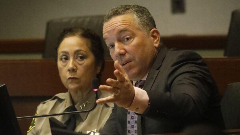 LOS ANGELES, CA - MARCH 26, 2019 - - Sheriff Alex Villanueva, right, addresses the issue of Secret D
