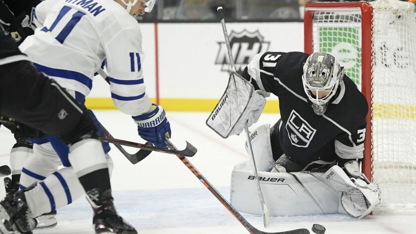 Toronto Maple Leafs left wing Zach Hyman, left, tries to get a shot past Kings goaltender Peter Budaj, of Slovakia, during the first period.