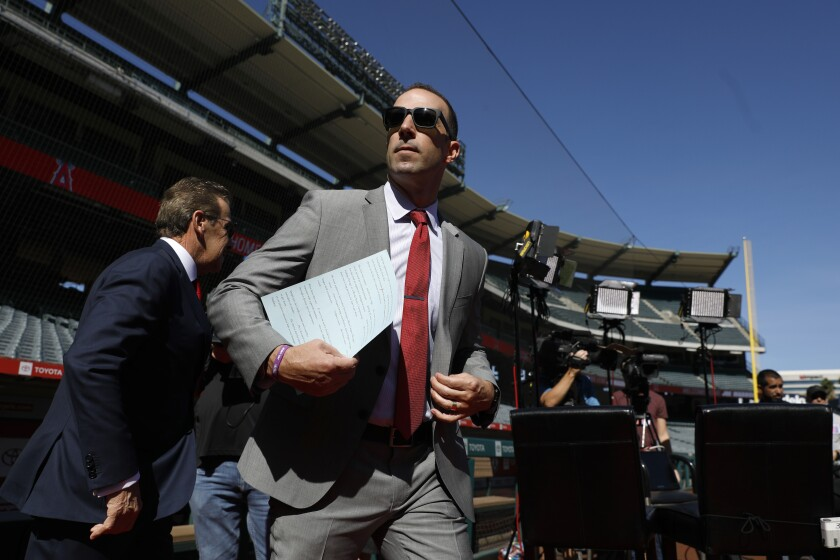 Angels General Manager Billy Eppler makes his way from the clubhouse as the Angels introduce Joe Maddon as latest manager at a press conference held at Angel Stadium in Anaheim on Oct. 24.