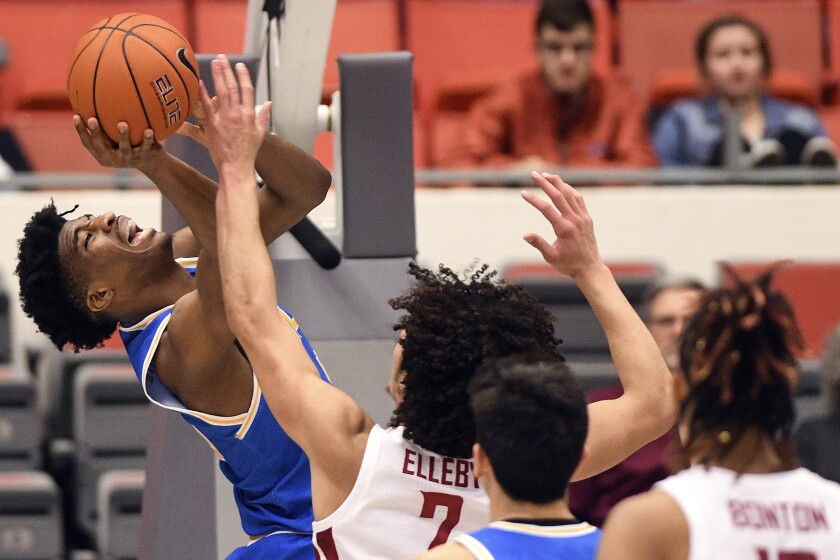 UCLA guard Chris Smith shoots over Washington State forward CJ Elleby during the first half of the Bruins' loss Saturday.