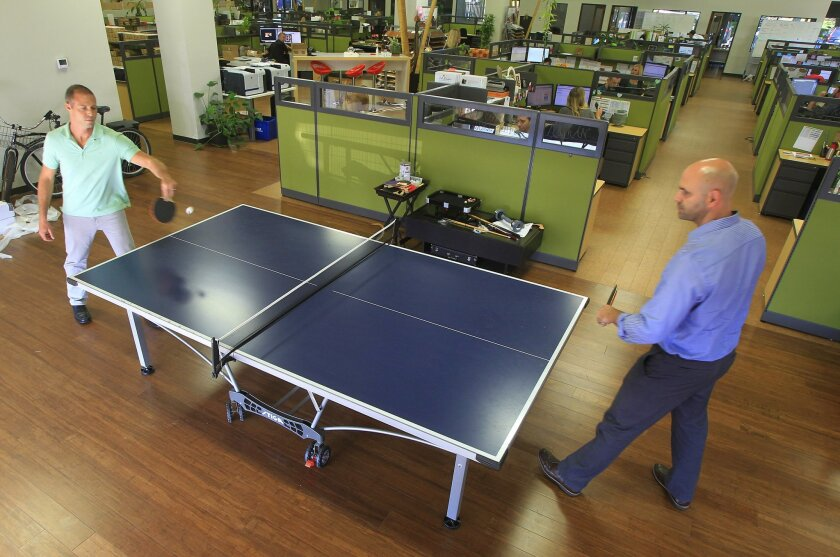 Cali Bamboo founders Jeff Goldberg (left) and Tanner Haigwood play ping-pong at Sorrento Mesa headquarters. EDUARDO CONTRERAS • U-T