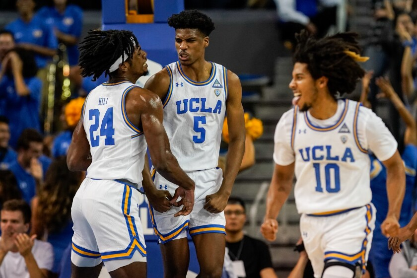 UCLA Bruins forward Jalen Hill (24) and guard Chris Smith (5) celebrate Smith scoring during the first half against Long Beach State at Pauley Pavillion on Nov. 6, 2019.