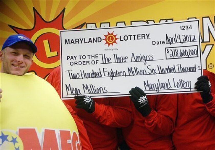 In this photo provided by the Maryland State Lottery Agency, a lottery official, left, and the three anonymous winners of the Maryland portion of the Mega Millions lottery pose for a photo in Baltimore, Tuesday, April 10, 2012. Maryland Lottery officials say three public school employees are sharing the spoils of the record Mega Millions jackpot. The winning Maryland ticket is one of three nationally that split the $656 million jackpot. (AP Photo/Maryland State Lottery Agency)