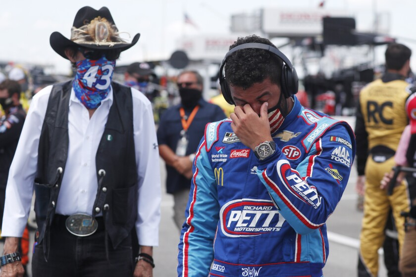 NASCAR driver Bubba Wallace and team owner Richard Petty walk to Wallace's car at Talladega.