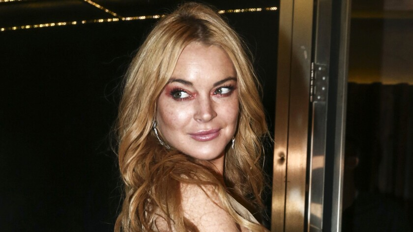 FILE - In this Oct. 16, 2016, file photo, actress Lindsay Lohan appears at the opening night of the