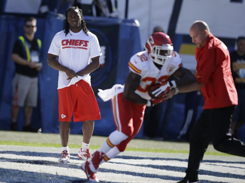Kansas City Chiefs running back Jamaal Charles, left, looks on as teammate running back Cyrus Gray, second from right, warms up before playing the San Diego Chargers in an NFL football game Sunday, Dec. 29, 2013, in San Diego. (AP Photo/Lenny Ignelzi)