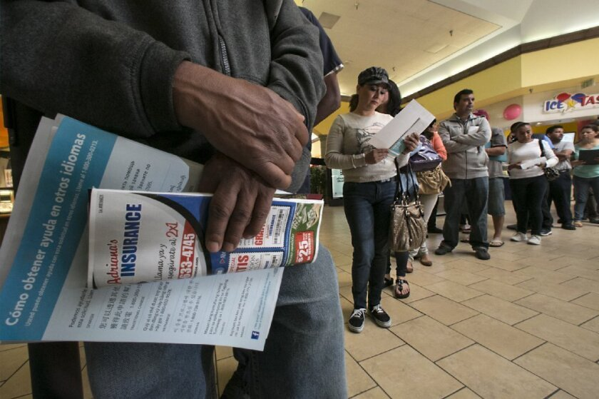 The surge is happening: Customers line up in Panorama City over the weekend to sign up for Obamacare.
