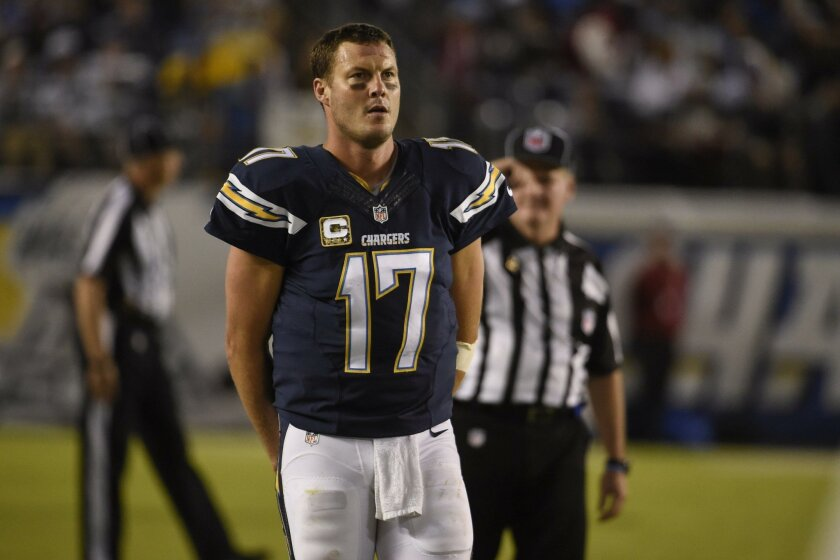 San Diego Chargers quarterback Philip Rivers looks on during the second half of an NFL football game against the Chicago Bears Monday, Nov. 9, 2015, in San Diego. (AP Photo/Denis Poroy)