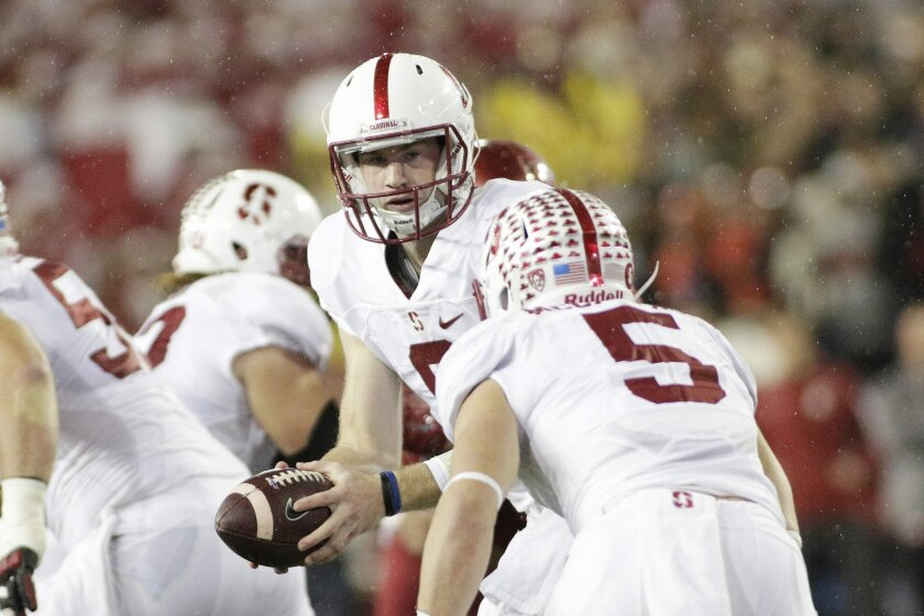 Stanford quarterback Kevin Hogan, center, hands the ball off to running back Christian McCaffrey (5) during the first half of an NCAA college football game against Washington State, Saturday, Oct. 31, 2015, in Pullman, Wash. (AP Photo/Young Kwak)