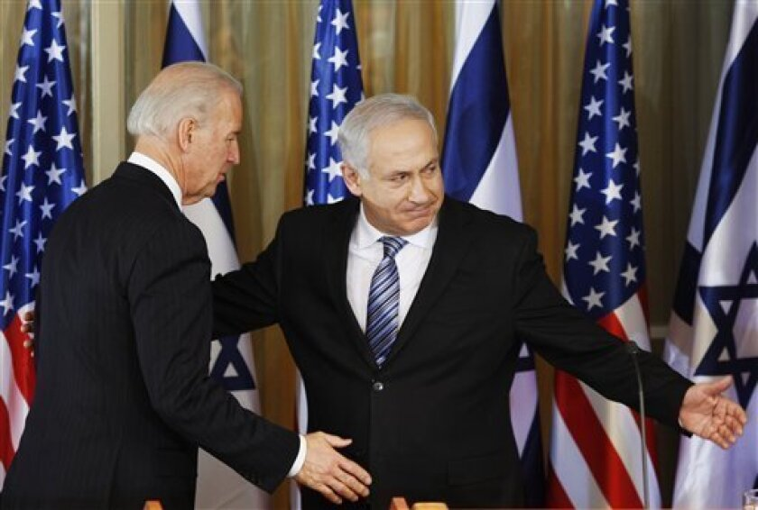 """U.S Vice President Joe Biden , left, and Israel's Prime Minister Benjamin Netanyahu  react after delivering a statement at the Prime Minister's residence in Jerusalem, Tuesday, March 9, 2010. Biden said there is a """"moment of opportunity"""" for peace between Israelis and Palestinians.(AP Photo/Ariel S"""