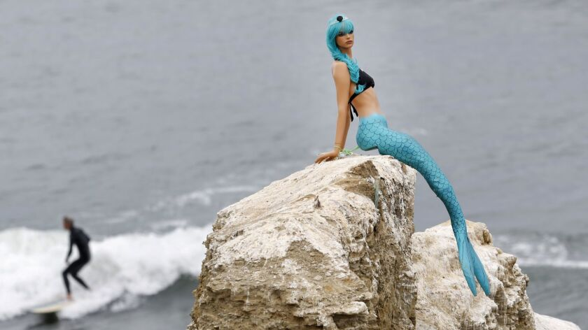"""The mermaid mannequin that mysteriously appeared on Ross Rock in Sunset Cliffs late last month disappeared June 14. Ocean Beach residents have mixed emotions, with one person calling it their version of the """"Cardiff Kook."""""""
